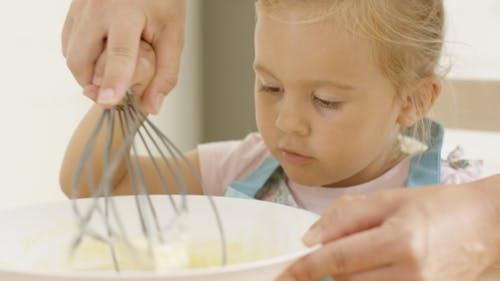 Fascinated Little Girl Learning To Bake