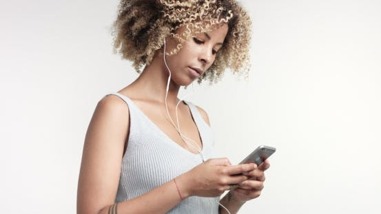 Thumbnail for Portrait of Beauty Mixed Race Woman with Afro Hair and Freckles with Earphones and Smartphone