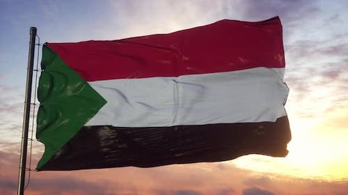 Flag of Sudan Waving in the Wind Against Deep Beautiful Sky at Sunset