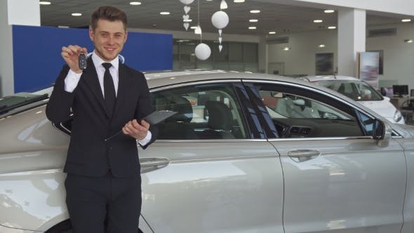 Thumbnail for Sales Manager Shows Key at the Dealership