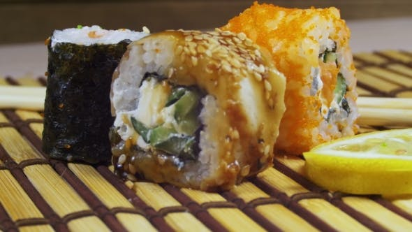 Thumbnail for Sushi Rolls on a Bamboo Mat Rotates