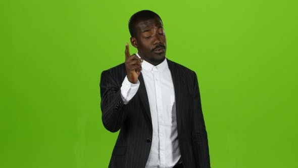 Thumbnail for Man of African Nationality Stands and Scolds His Subordinates with His Finger. Green Screen