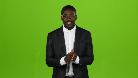 Thumbnail for Black African American Guy Claps His Hands and Smiles. Green Screen