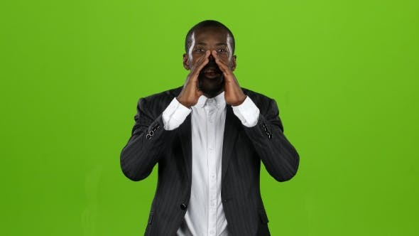 Thumbnail for Businessman African American Loudly Calling People To Him. Green Screen