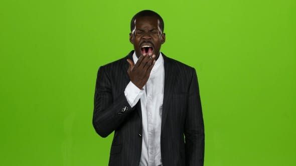 Thumbnail for African American, Very Tired at Work and Wants To Sleep, He Yawns. Green Screen