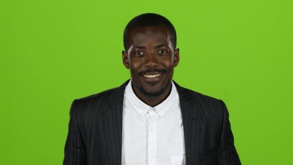 African American Wonderful Guy, sein Lächeln erobert alle, und Lachen ist ansteckend. Grüner Bildschirm.