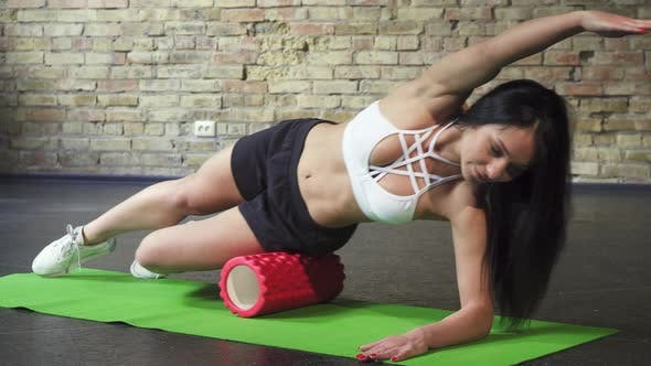 Thumbnail for Gorgeous Fitness Woman Relaxing After Fitness Using Foam Roller