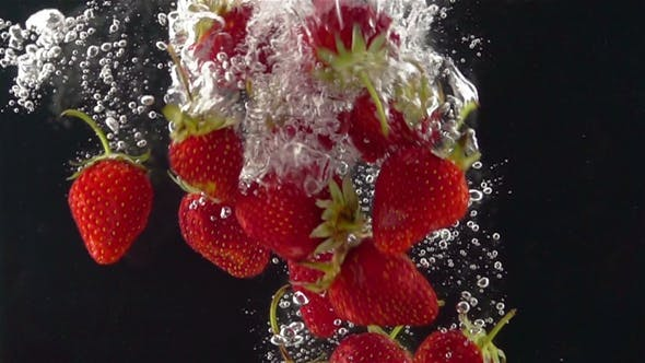 Thumbnail for Ripe Strawberries Falling through the Water.