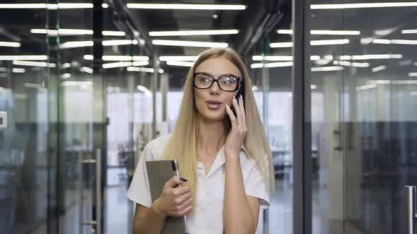 Businesswoman in Glasses which Talking on Phone