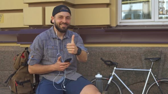 Thumbnail for Cyclist Shows His Thumb Up on the Street