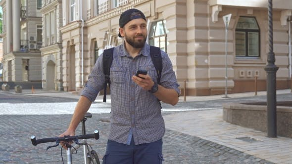Thumbnail for Cyclist Uses Cellphone on the Street