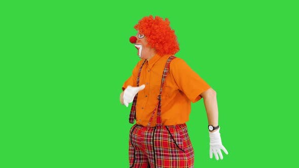 Funny Clown Being Late Looking at His Watch but Takes It Easy on a Green Screen Chroma Key