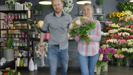 Thumbnail for Couple Leaving Shop with Bouquet