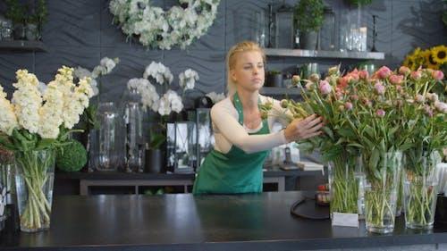 Woman Arranging Bouquets