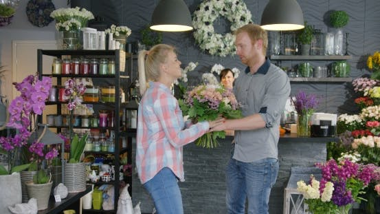 Thumbnail for Couple with Flowers in Shop