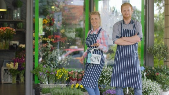 Thumbnail for People Posing in Aprons Near Shop