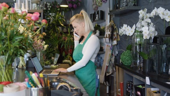 Thumbnail for Woman with Gadgets Working in Shop