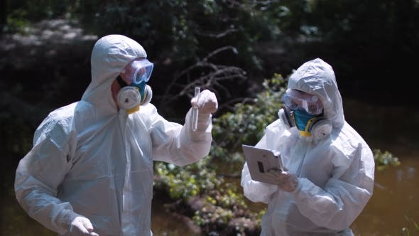 Thumbnail for Two Ecological Workers in Biohazard Suits Sampling Water