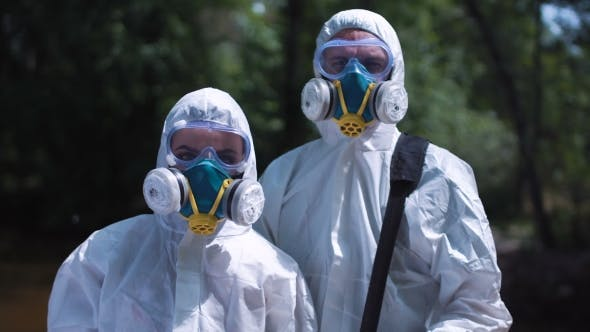 Two Ecologists in Environmental Suits