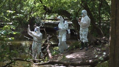 Three Bio Technicians Testing for Pollutants