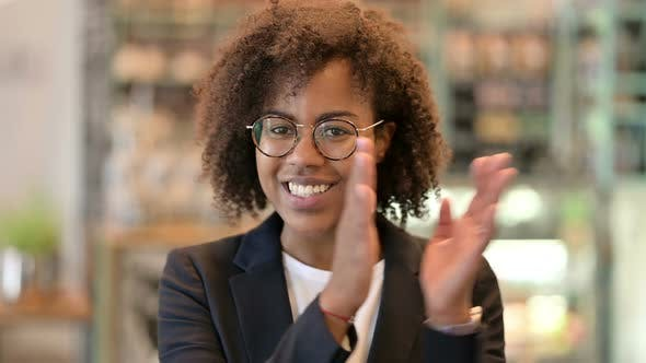 Excited Young African Businesswoman Clapping