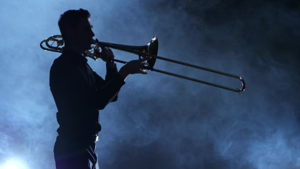 Thumbnail for Silhouette Professional Musician Man Playing on Trumpet. Smoky Isolated Studio
