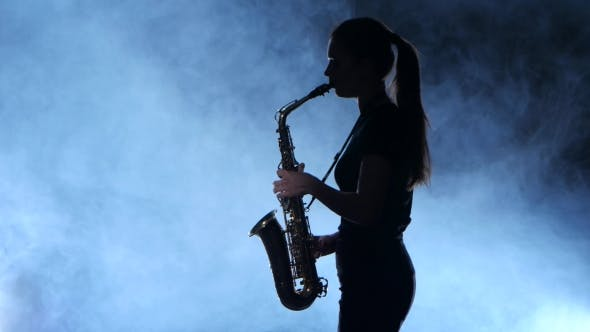 Thumbnail for Silhouette Professional Musician Female Playing on Saxophone. Smoky Isolated Studio
