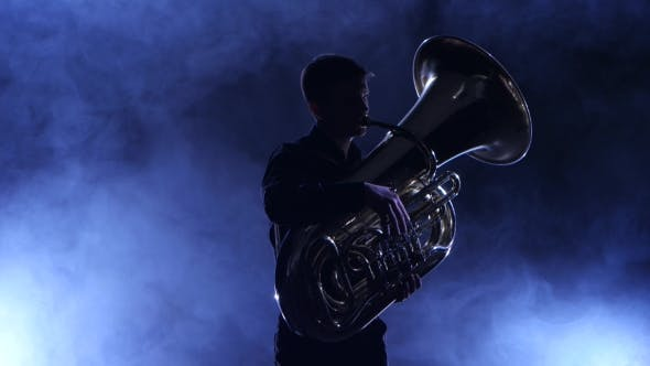 Thumbnail for Musician in a Smoky Studio Playing in a Tuba, Silhouette