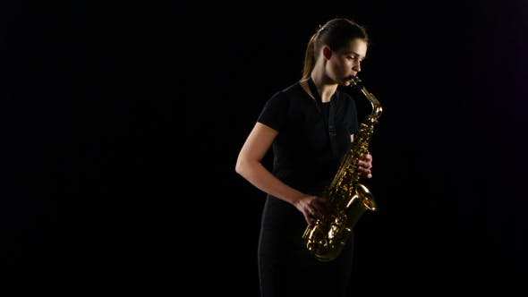 Thumbnail for Female Plays on the Saxophone Jazz Melody. Black Studio Background
