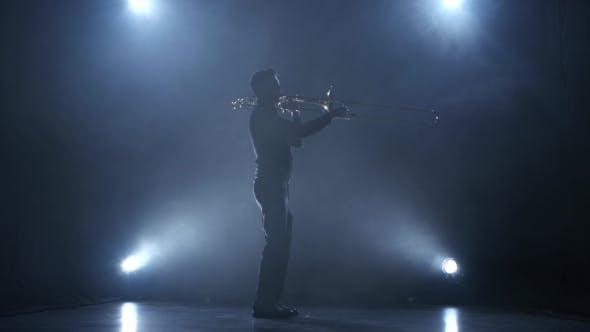 Thumbnail for Instrumentalist Plays on a Trumpet Classical Melody. Studio in Smoke