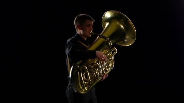 Thumbnail for Man Plays on the Tuba Slow Melody. Black Studio Background