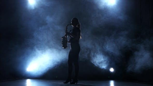 Thumbnail for Instrumentalist Woman Plays on Wind Instrument Saxophone Melody. Smoky Studio