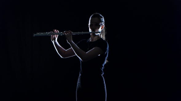 Thumbnail for Female Musician Blows the Motif in Flute on Black Studio