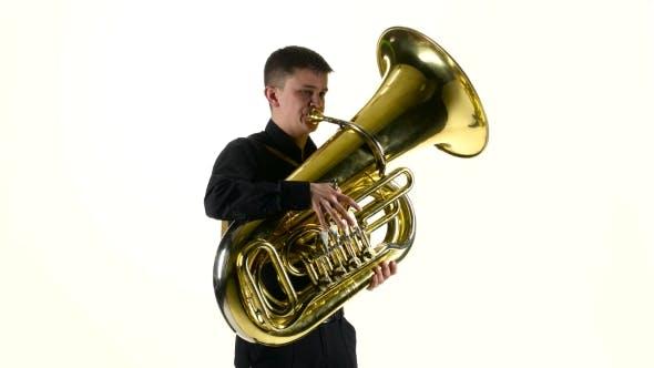 Thumbnail for Man Plays on the Tuba Slow Melody. White Studio Background