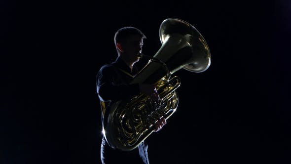 Thumbnail for Man Plays on the Tuba Slow Melody in Black Studio