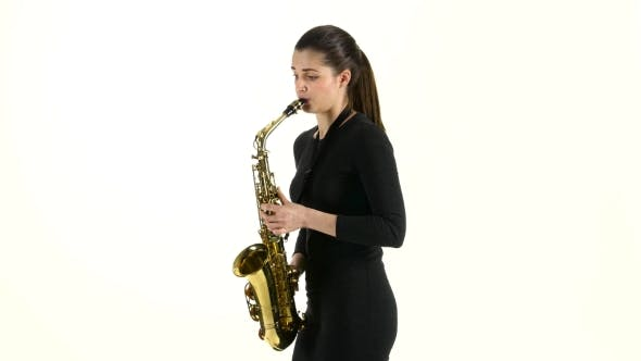 Cover Image for Female Musician Playing on Saxophone Standing Sideways on White Background