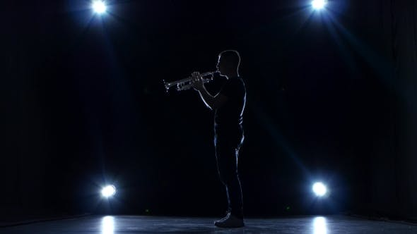 Thumbnail for Musician in Dark Studio with Spotlights Playing Trumpet Slow Jazz