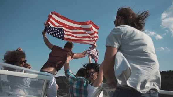 Cover Image for Group of Young People Raise American Flag