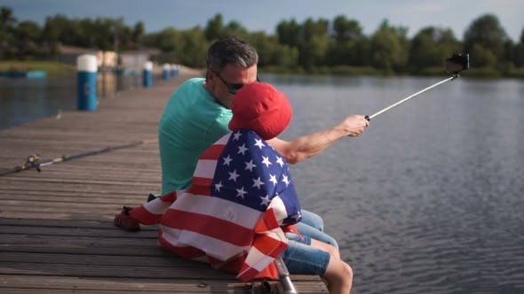 Thumbnail for Father and Son Posing with American Flag