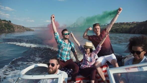 Cover Image for People on Boat with Colored Smoke