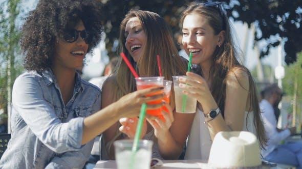 Thumbnail for Smiling Women Clinking Glasses