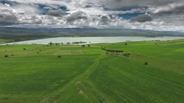 Thumbnail for Green Meadows and Fields Around The Lake with Aerial View