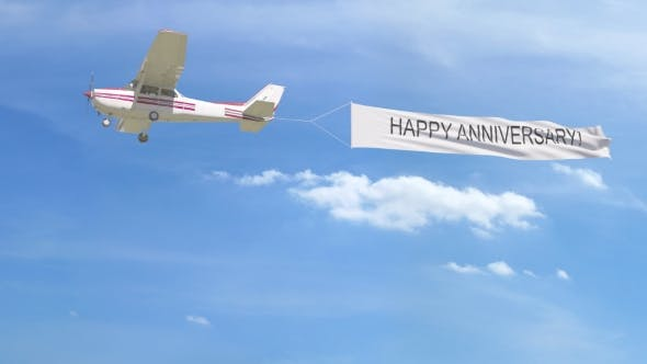 Thumbnail for Small Propeller Airplane Towing Banner with HAPPY ANNIVERSARY Caption in the Sky