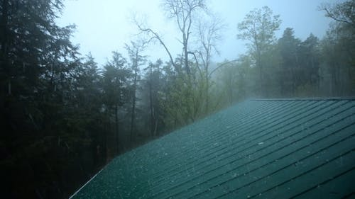 Extreme Weather Hail Hitting Roof During Storm