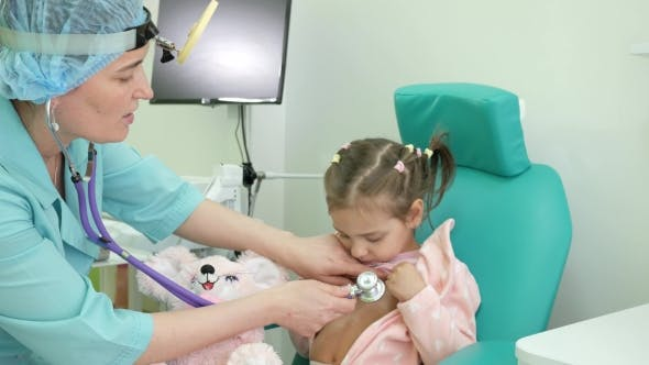 Cover Image for Happy Child at Doctor's Reception, Consultation of ENT Doctor, Otoscopy, Advice Otolaryngologist in