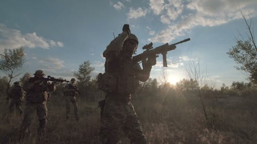 Soldiers Aiming on Battlefield