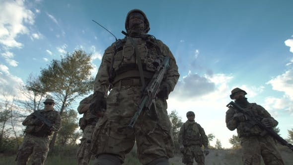Soldiers Standing on Field