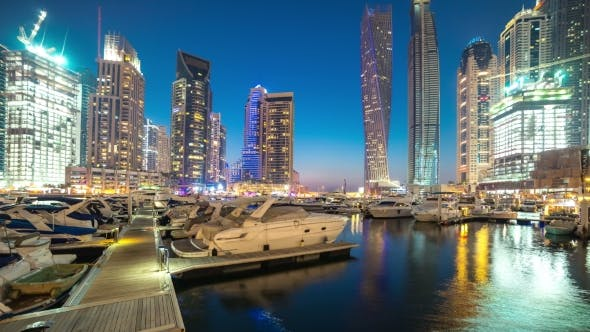 Cover Image for Glittering Lights and Tallest Skyscrapers During a Clear Evening with Blue Sky