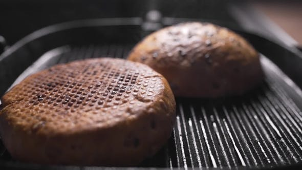 Thumbnail for Roasting Crispy Buns for Burgers, Making Hamburger, Fast Food, Cooking at Home, Buns Is Grilled