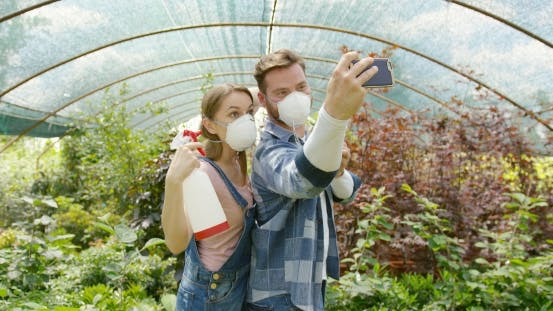 Cover Image for Gardeners Taking Selfie with Respirator